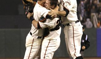San Francisco Giants pitcher Matt Cain, left, celebrates with catcher Buster Posey, center, and first baseman Brandon Belt after the final out of the ninth inning of against the Houston Astros in San Francisco on Wednesday, June 13, 2012. Cain pitched the 22nd perfect game in major league history and first for the Giants, striking out a career-high 14 and getting help from two spectacular catches to beat the Houston Astros 10-0. (AP Photo/Jeff Chiu)