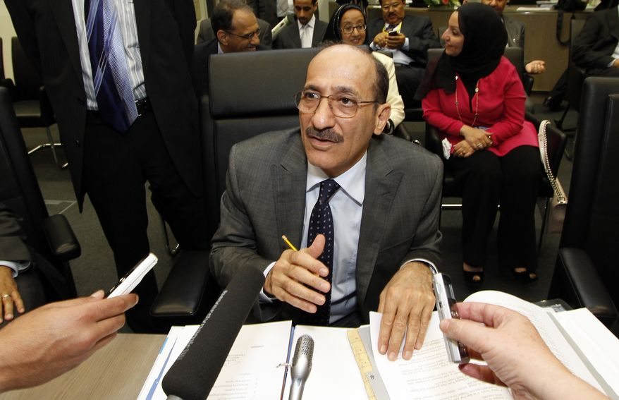 Kuwaiti Oil Minister Hani Abdulaziz Hussain speaks to journalists before the start of the meeting of the Organization of the Petroleum Exporting Countries at their headquarters in Vienna, Austria, on Thursday, June 14, 2012. (AP Photo/Ronald Zak)