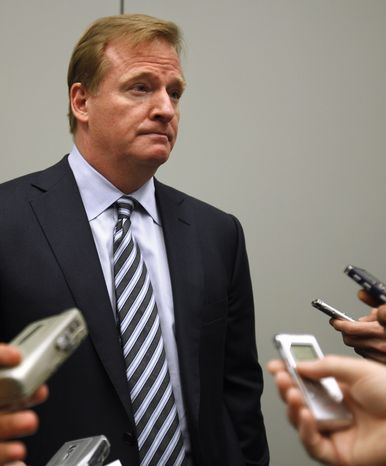 **FILE** NFL Commissioner Roger Goodell talks Oct. 3, 2011, in Washington to reporters after speaking about concussions at the Congress of Neurological Surgeons. (Associated Press)