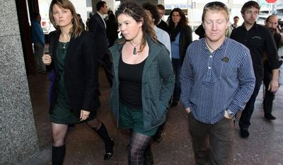 Actress Lucy Lawless (left) and Greenpeace activists Viv Hadlow and Raoni Hammer walk outside Auckland District Court in Auckland, New Zealand, on Thursday, June 14, 2012, after answering charges related to the occupation of the oil-drilling ship the Noble Discoverer in February. (AP Photo/Greenpeace)