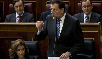 Spain's Prime Minister Mariano Rajoy speaks June 13, 2012, in Madrid during a control session at the Spanish Parliament. (Associated Press)