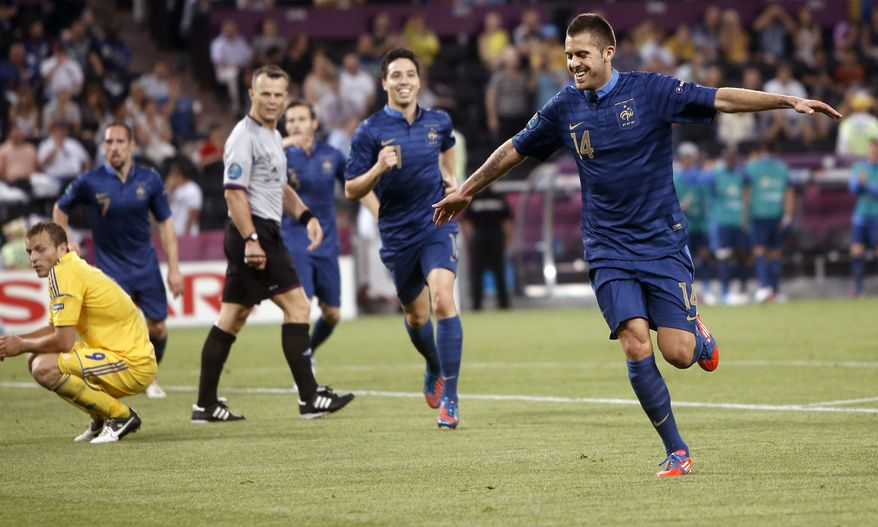 France's Jeremy Menez, right, celebrates after scoring during the Euro 2012 Group D match between Ukraine and France in Donetsk, Ukraine, on Friday, June 15, 2012. France won 2-0. (AP Photo/Laurent Cipriani)