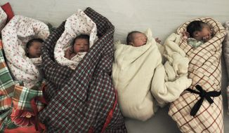 **FILE** Newborn babies wait to be bathed Jan. 25, 2012, at a hospital in Zouping county in east China's Shandong province. (Associated Press)