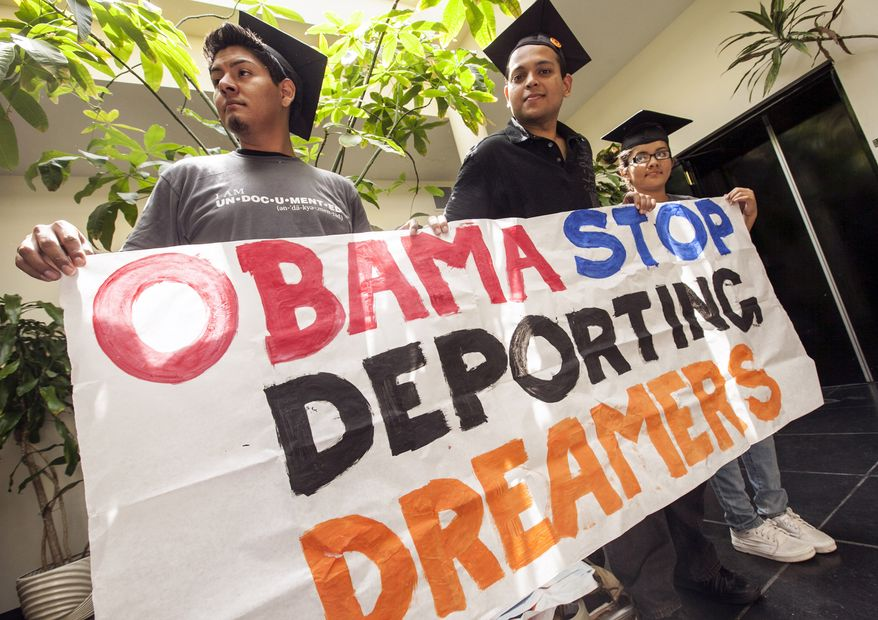 From left: Students David Buenrostro, Adrian James, and Jahel Ramos protest June 14, 2012, outside the Obama campaign offices in Culver City, Calif. The students demand that President Obama issue an executive order to stop deportations of illegal immigrant students in favor of the DREAM Act (Development, Relief, and Education for Alien Minors). In July 2011, California Gov. Brown enacted the California DREAM Act, giving illegal immigrant students access to private college scholarships for state schools. (Associated Press)