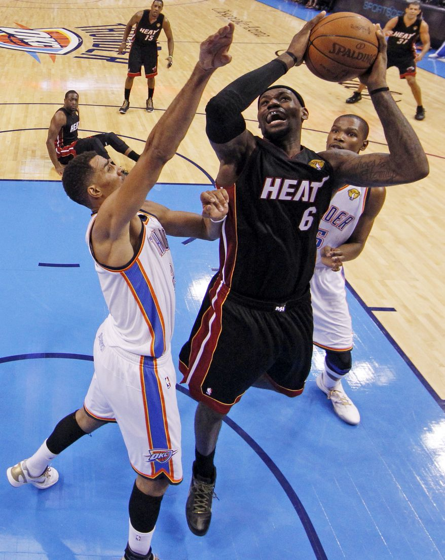 Miami Heat small forward LeBron James scored 32 points and had eight rebounds in his team's 100-96 win in Game 2 of NBA finals against the Oklahoma City Thunder. (AP Photo/Jim Young, Pool)