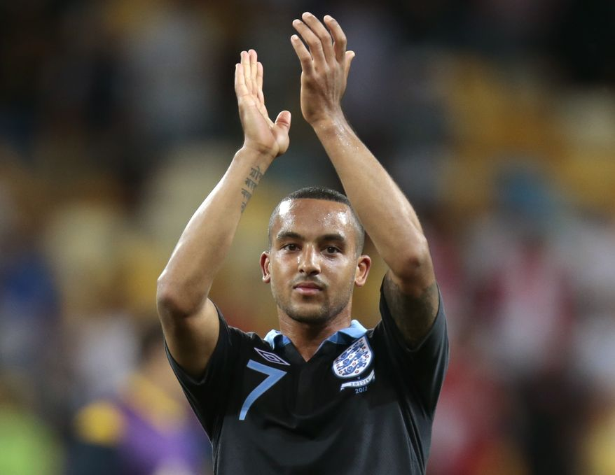 England's Theo Walcott applaud the supporters at the end of the Euro 2012 Group D match between Sweden and England in Kiev, Ukraine on Friday, June 15, 2012. England won 3-2. (AP Photo/Ivan Sekretarev)
