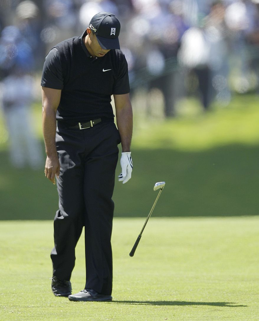 Tiger Woods drops his club after a shot on the sixth hole during the second round of the U.S. Open Championship on Friday, June 15, 2012, at The Olympic Club in San Francisco. (AP Photo/Ben Margot)