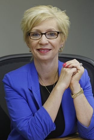 "This Friday, June 15, 2012 photo shows Kathy Miller, president of Total Event Resources, at her offices in Schaumburg, Ill. In 2008, her events planning company was having its best year ever. She and her husband had set aside money to put their two sons through college, with enough left in savings for ""a very nice life"" in the Chicago suburb. Then the financial crisis sent the stock market tumbling and the corporate customers who had kept Miller's company busy, stopped calling. When the government reported that the Great Recession claimed nearly 40 percent of Americans' wealth, the figure alarmed economists. But for families across the country, the numbers merely confirm that they are not alone. (AP Photo/M. Spencer Green)"
