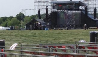 This photo provided by Alexandra Mihan shows a stage before it collapsed at the site for a Radiohead concert at Downsview Park in Toronto on Saturday, June 16, 2012. Toronto paramedics say one person is dead and another is seriously hurt after the stage collapsed while setting up for a Radiohead concert. They say two other people were injured and are being assessed. (AP Photo/Alexandra Mihan via The Canadian Press)