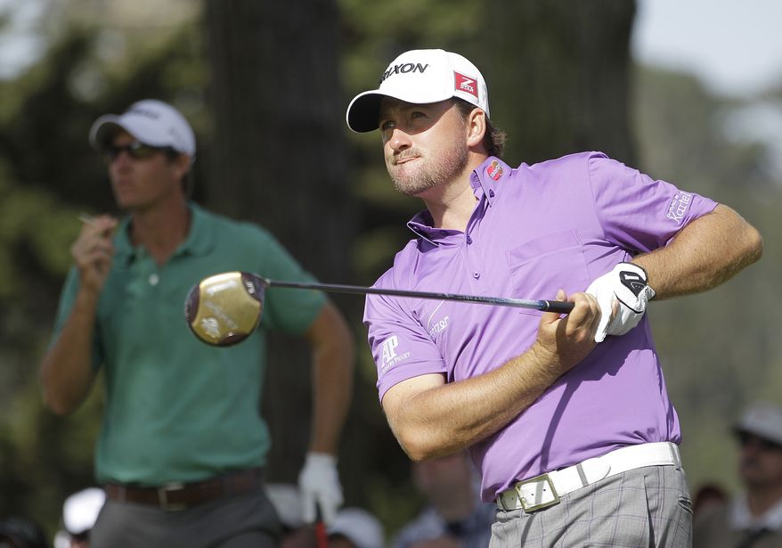 Heading into the final day at the U.S. Open, Grame McDowell and Jim Furyk share the lead at 1-under par. (AP Photo/Ben Margot)