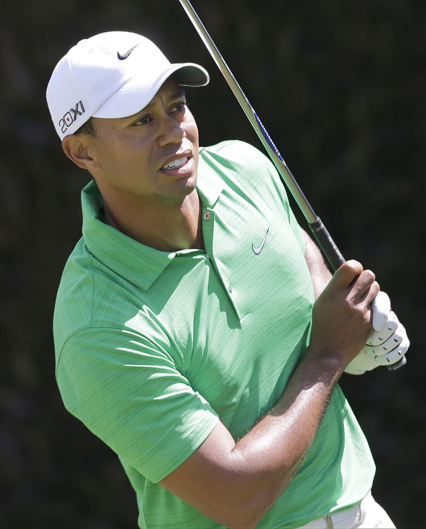Tiger Woods watches his drive on the first tee during the third round of the U.S. Open Championship on Saturday, June 16, 2012, at The Olympic Club in San Francisco. (AP Photo/Eric Gay)