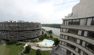 This photo taken May 30, 2012 shows a view of the Watergate complex from the top floor of the Watergate Office Building in Washington. Forty years ago police in Washington arrested five men breaking in to the Democratic National Committee offices. The name of the complex they were breaking into became infamous: the Watergate. These days, though, unless you know where to look, there's little marking the location of the 1972 crime that ultimately led to the resignation of President Nixon. (AP Photo/Susan Walsh)