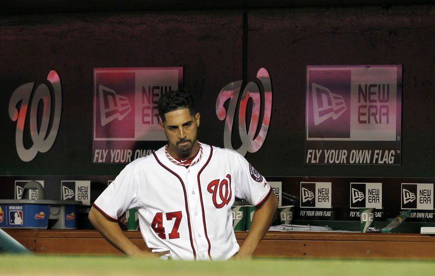 Washington Nationals starting pitcher Gio Gonzalez reacts after pulled from the game during the seventh inning against the New York Yankees at Nationals Park on Friday, June 15, 2012, in Washington. The Yankees won 7-2. (AP Photo/Alex Brandon)