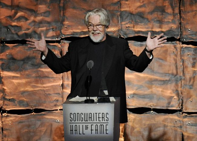 """Bob Seger was inducted into the Songwriters Hall of Fame on Thursday, opening the ceremony with a spirited version of his 1973 classic, """"Turn the Page."""" (Invision)"""