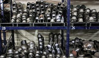 "Finished helmets prepared for Hollywood period movies and re-enactment events are stacked. Ashok Rai's factory has supplied replica military gear for the Russell Crowe movie ""Robin Hood"" and the Orlando Bloom movie about the Crusades, ""Kingdom of Heaven,"" among others. (Associated Press)"