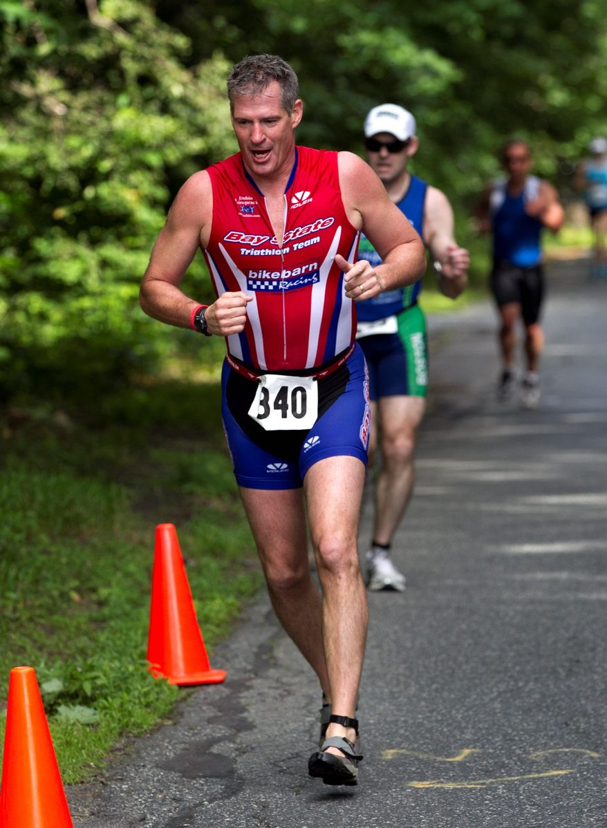 Sen. Scott P. Brown, Massachusetts Republican, runs a triathlon in Ashland, Mass., on Sunday. Mr. Brown is facing Democrat Elizabeth Warren in his bid for re-election. (Associated Press)
