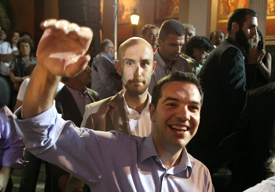 Alexis Tsipras, head of the left-wing Syriza Party, waves to his supporters in Athens late Sunday. The party won 72 seats in parliament. (Associated Press)