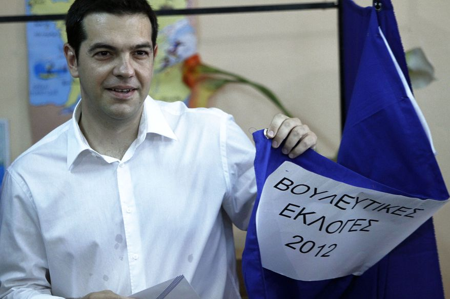 Alexis Tsipras, leader of Greece's radical left-wing Syriza party, casts his ballot at a voting center in Athens on Sunday, June 17, 2012. (AP Photo/Petros Karadjias)