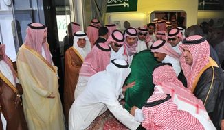 Relatives from the Saudi royal family lift the coffin of Crown Prince Sultan bin Abdul-Aziz Al Saud in Jiddah, Saudi Arabia, on Sunday, June 17, 2012. (AP Photo/Saudi Press Agency)