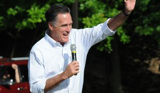 Republican presidential candidate Mitt Romney waves to the crowd during a campaign stop in Cornwall, Pa., on Saturday, June 16, 2012. (AP Photo/Lebanon Daily News, Earl Brightbill)