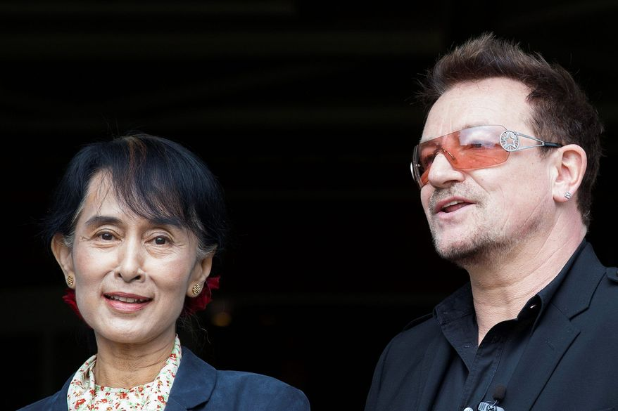Irish singer-activist Bono finally got to meet Myanmar opposition leader Aung San Suu Kyi, about whom he had written a song, near Oslo on Monday. (Associated Press)