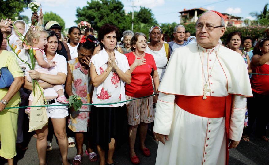 Cardinal Jaime Ortega attends a procession honoring the nation's patron saint, the Virgin of Charity of Cobre, in Havana on Nov. 10. A political cartoon that appeared in Miami's El Nuevo Herald showed the cardinal and a military-clad Cuban President Raul Castro singing a love song together, implying that the religious leader was a Castro lackey. (Associated Press)
