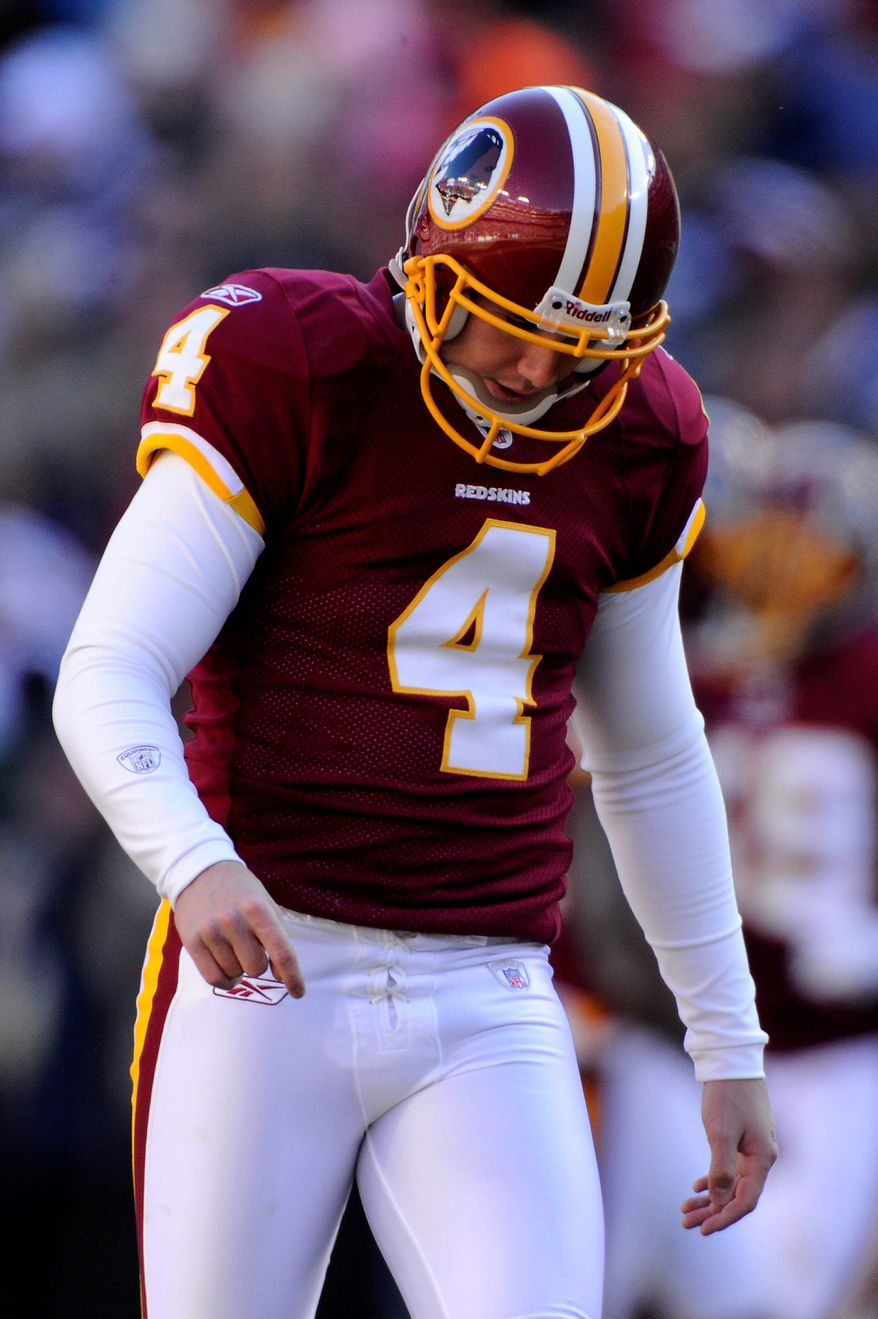 Washington Redskins kicker Graham Gano (4) walks with his head down after shanking a first quarter kickoff at FedEx Field in Landover, Md., on Sunday, December 11, 2011. (Preston Keres/Special to The Washington Times)
