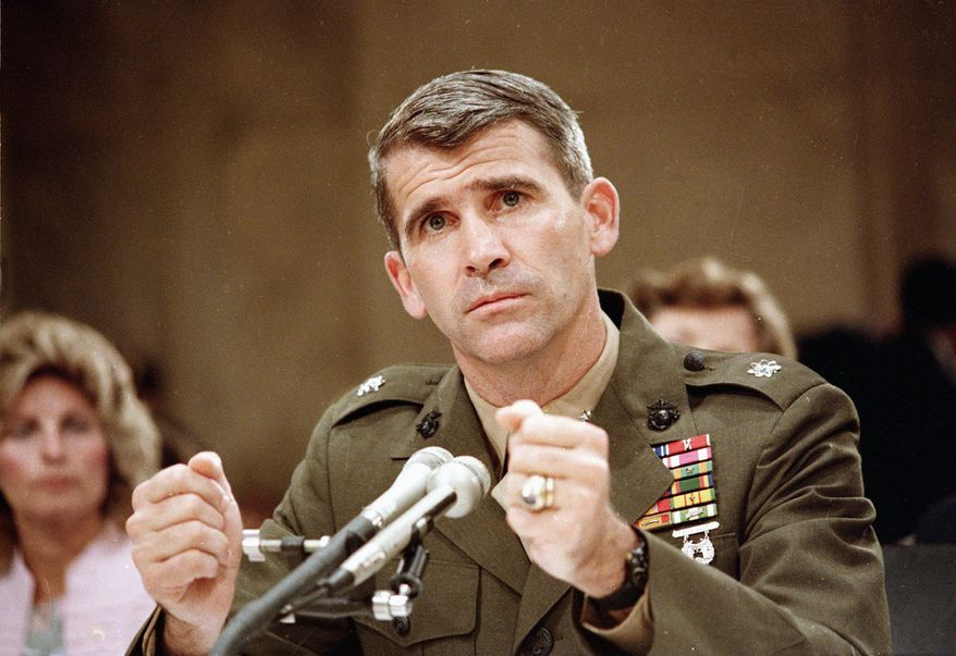 Lt. Col. Oliver North became a household name during the Iran-Contra scandal and the televised congressional hearings it sparked in 1987. In the years since, he has run for the U.S. Senate, written books, appeared on Fox News and now is serving as a pitchman for a video game. (Associated Press)