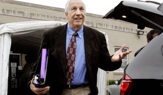 Former Penn State University assistant football coach Jerry Sandusky leaves the Centre County Courthouse in Bellefonte, Pa., on Monday. Mr. Sandusky is charged with 52 counts of child sexual abuse involving 10 boys over a period of 15 years. (Associated Press)