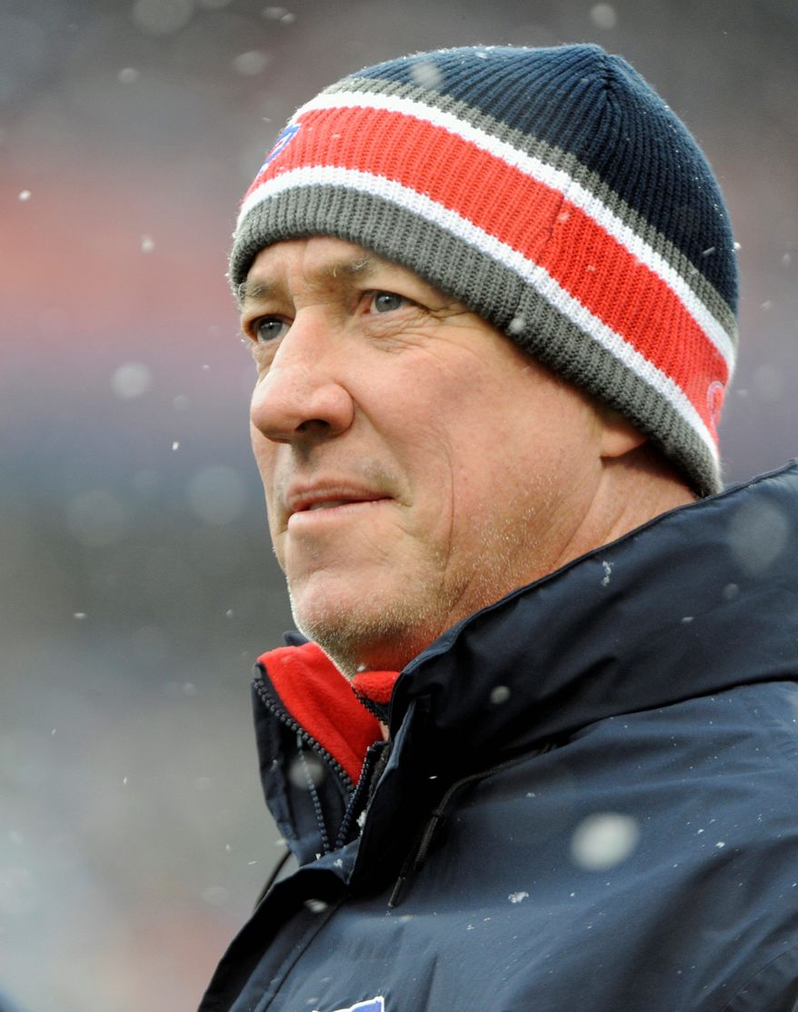FILE - In this Dec. 18, 2011 file photo, Buffalo Bills alumni quarterback Jim Kelly looks out onto the field during the Miami Dolphins and Buffalo Bills NFL football game in Orchard Park, N.Y. Kelly is a recipient of the 2012 Jefferson Award. (AP Photo/Gary Wiepert)