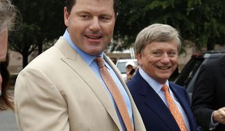 Former Major League Baseball pitcher Roger Clemens (left) and his attorney Rusty Hardin arrive June 18, 2012, at federal court for Clemens' perjury trial. (Associated Press)