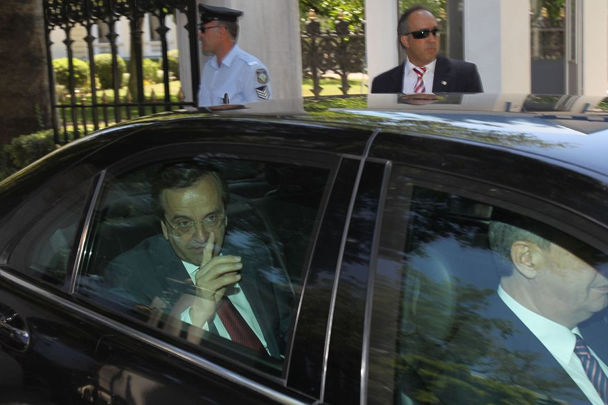 Antonis Samaras, whose conservative party placed first in Greece's election, leaves the Presidential Palace in Athens after meeting with President Karolos Papoulias on Monday, June 18, 2012. (AP Photo/Petros Karadjias)