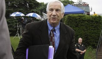 Former Penn State assistant football coach Jerry Sandusky arrives at the Centre County Courthouse in Bellefonte, Pa., on Monday, June 18, 2012. (AP Photo/Gene J. Puskar)