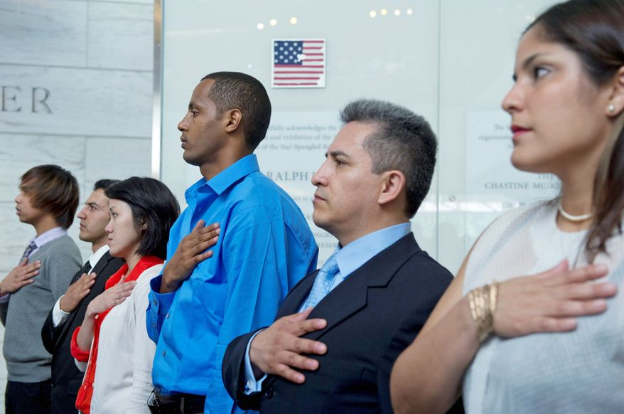 Immigrants take part in a naturalization ceremony at the Museum of American History in the District last month. For the first time, the influx of Asians moving to the U.S. has surpassed that of Hispanics. (Barbara L. Salisbury/The Washington Times)