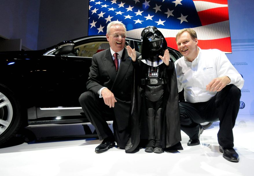 Martin Winterkorn, Chairman of the Board of Management of Volkswagen AG, eight-year-old Max Page, who plays Darth Vader in the Passat commercial, and Frank Fischer, Chairman and CEO of Volkswagen of America Chattanooga, pose in front of a new Passat as Volkswagen hosted a grand opening of its new plant and to launch its all-new Passat in Chattanooga, Tenn., Wednesday. May 24, 2011. (AP Photo/Billy Weeks)