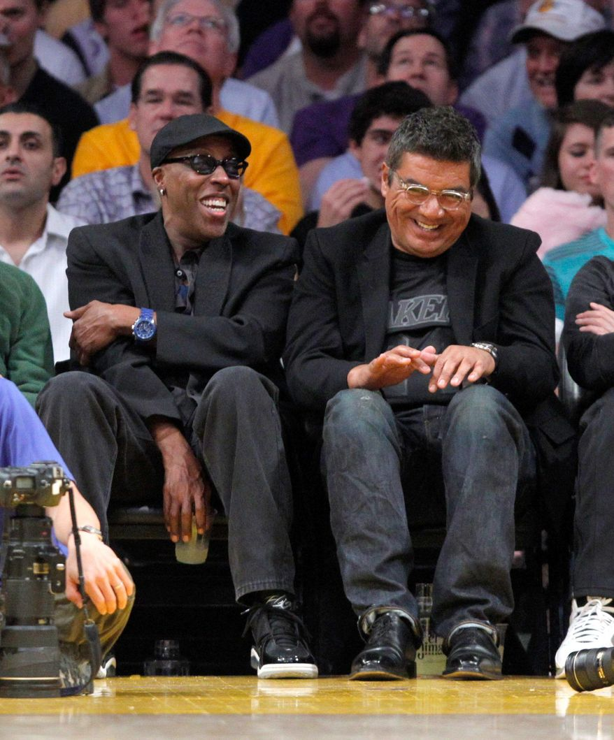 Arsenio Hall and George Lopez during an NBA basketball game between the Los Angeles Lakers and the Dallas Mavericks in Los Angeles, Thursday, March 31, 2011. The Lakers won 110-82. (AP Photo/Jae C. Hong)