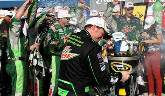 Dale Earnhardt Jr. celebrates after winning the Quicken Loans 400 at Michigan International Speedway, his first Sprint Cup victory in 143 races. Next up is Sonoma, a California road course on which he hasn't fared well. (Associated Press)