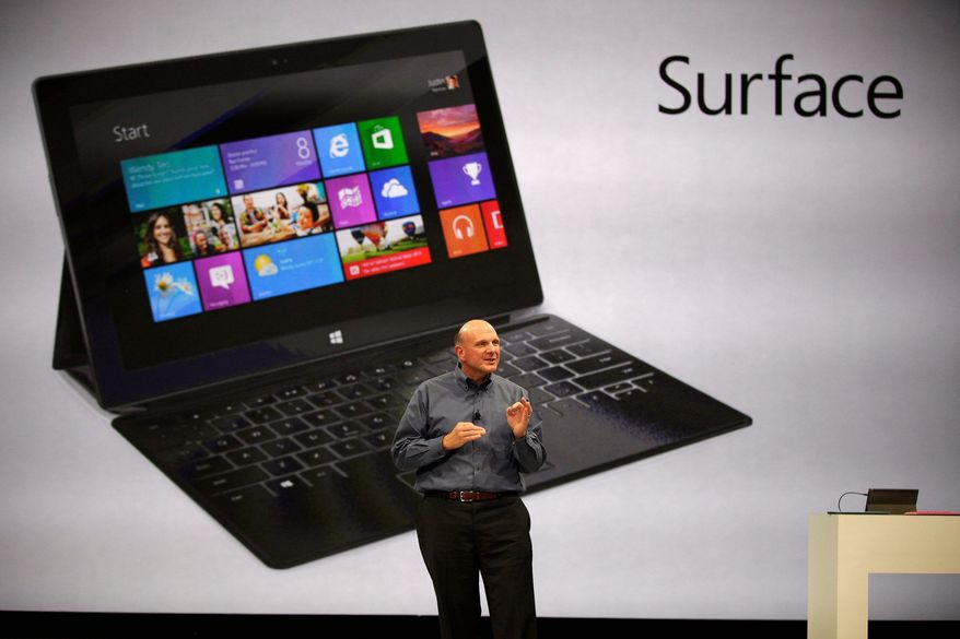 """Microsoft CEO Steve Ballmer unveils """"Surface"""", a new tablet computer to compete with Apple's iPad, at Hollywood's Milk Studios in Los Angeles Monday, June 18, 2012. The 9.3 millimeter thick tablet comes with a kickstand to hold it upright and keyboard that is part of the device's cover. It weighs under 1.5 pounds. (AP Photo/Damian Dovarganes)"""