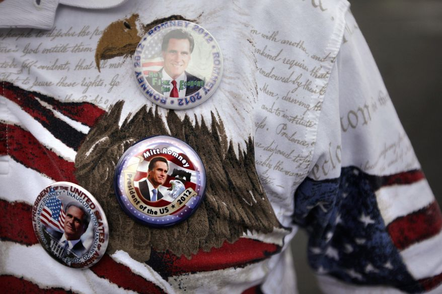 A supporter wears campaign buttons for Republican presidential candidate Mitt Romney at a campaign stop in Chantilly, Va. Do-this-get-that enticements are coming fast and furiously from political campaigns for national and local positions. (Associated Press)