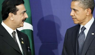 **FILE** Pakistani Prime Minister Syed Yusuf Raza Gilani (left) speaks March 27, 2012, to President Obama during their bilateral meeting on the sidelines of the Nuclear Security Summit in Seoul. (Associated Press)