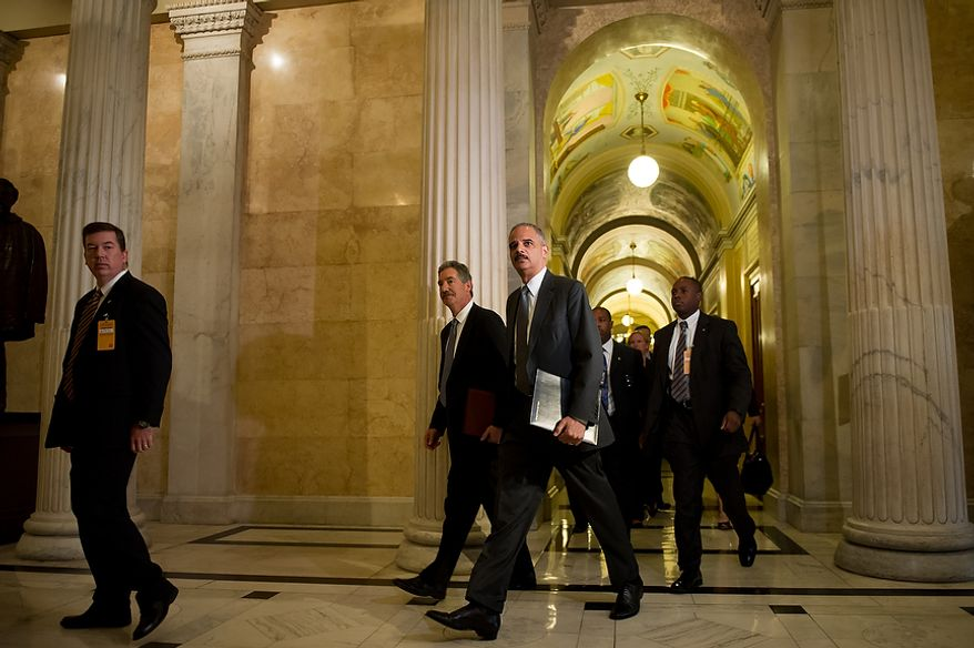 Attorney General Eric H. Holder Jr. arrives with Deputy Attorney General James Cole (second from left) at the U.S. Capitol in Washington on Tuesday, June 19, 2012, to meet with the House leadership to discuss the congressional investigation into the botched anti-gunrunning Fast and Furious operation. (Andrew Harnik/The Washington Times)