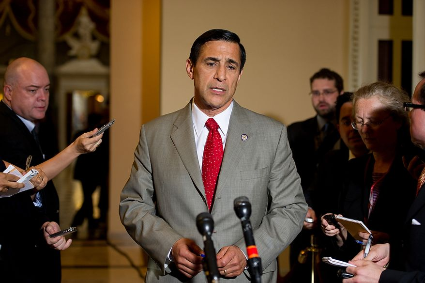 Rep. Darrell E. Issa (center), California Republican and chairman of the House Oversight and Government Reform Committee, speaks to the media after meeting with Attorney General Eric H. Holder Jr. at the U.S. Capitol in Washington on Tuesday, June 19, 2012, to discuss the congressional investigation into the botched anti-gunrunning Fast and Furious operation. (Andrew Harnik/The Washington Times)