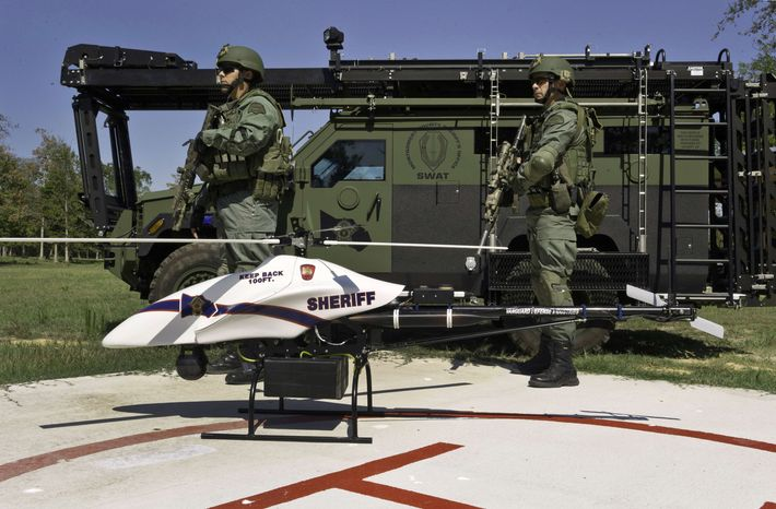** FILE ** This September 2011 file photo provided by Vanguard Defense Industries, shows a ShadowHawk drone with Montgomery County, Texas, SWAT team members. The prospect that thousands of drones could be patrolling U.S. skies by the end of this decade is raising the specter of a Big Brother government that peers into backyards and bedrooms. (AP Photo/Lance Bertolino, Vanguard Defense Industries)