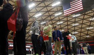 **FILE** People wait April 10, 2012, in a line at a job fair in Gresham, Ore. (Associated Press)