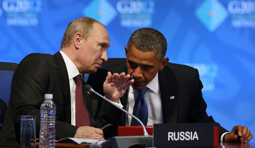 President Obama listens June 18, 2012, to Russian President Vladimir Putin before the opening of the first plenary session of the G-20 Summit in Los Cabos, Mexico. (Associated Press)