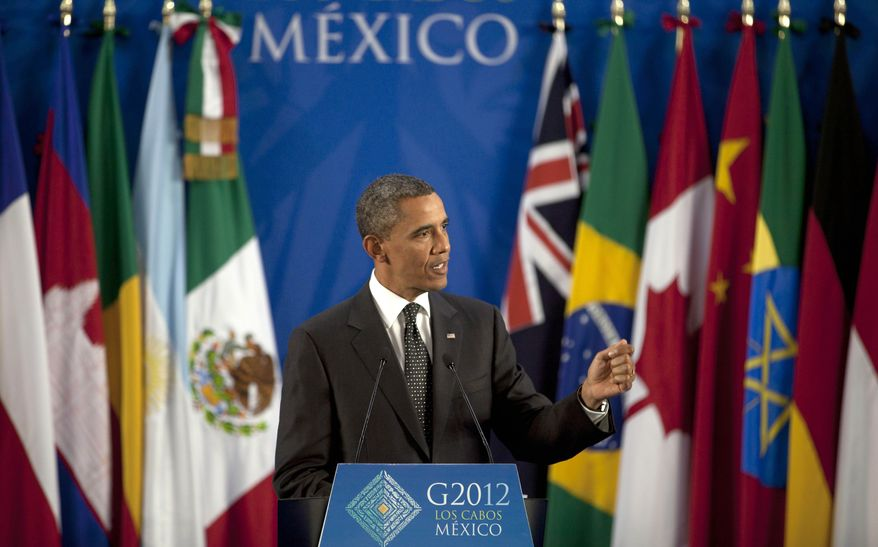 President Obama speaks during a press conference at the G20 summit in Los Cabos, Mexico, Tuesday, June 19, 2012. (AP Photo/Esteban Felix)