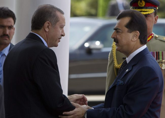 **FILE** Turkish Prime Minister Recep Tayyip Erdogan (left) shakes hands May 22, 2012, with Pakistani Prime Minister Yousuf Raza Gilani at his house in Islamabad, Pakistan. (Associated Press)