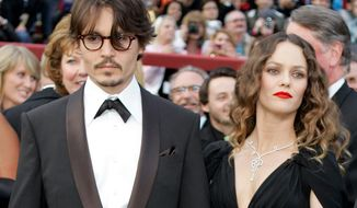 **FILE** Actor Johnny Depp arrives Feb. 24, 2009, with girlfriend Vanessa Paradis for the 80th Academy Awards in Los Angeles. (Associated Press)