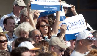 Supporters of Republican presidential candidate and former Massachusetts Gov. Mitt Romney listen to him speak June 19, 2012, during a campaign event at Bavarian Inn Lodge iin Frankenmuth, Mich. (Associated Press/The Saginaw News)