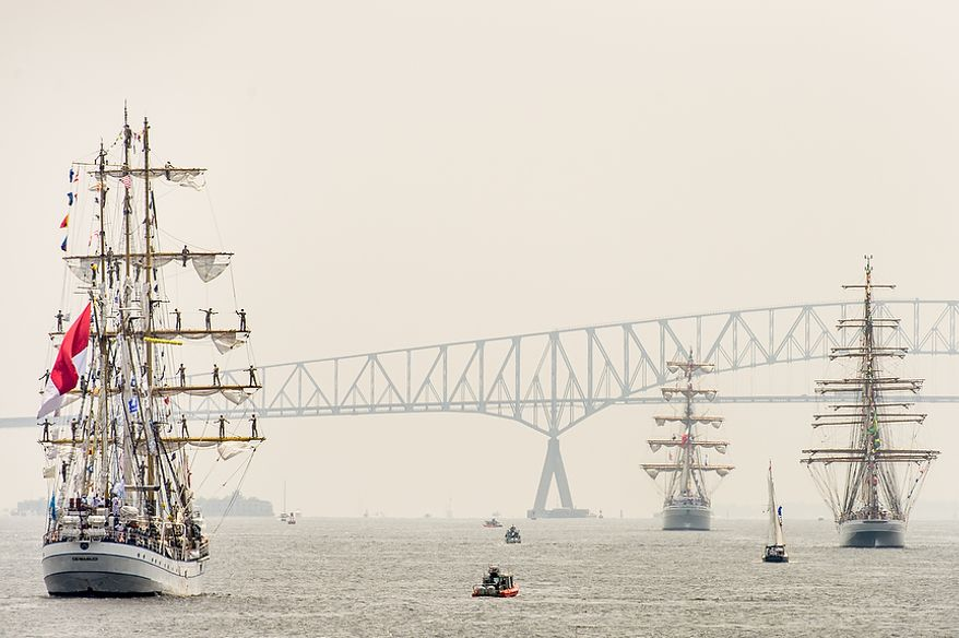 The Dewaruci from Indonesia, left, the Cisne Branco from Brazil, right, and the Cuauhtémoc from Mexico, second from right, all tall ships, sail out of Baltimore Harbor after celebrating the Bicentennial of the War of 1812 and the writing of the Star-Spangled Banner as part of a week long international tall ship and naval vessel parade called the Star-Spangled Sailabration, Baltimore, Md., Tuesday, June 19, 2012. (Andrew Harnik/The Washington Times)
